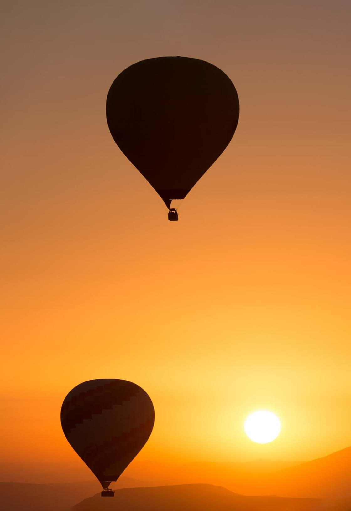 image of two air balloons in sunrise